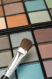 Eye shadow palette with a brush Royalty Free Stock Photo