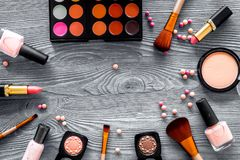 Eye shadow palette, brushes, lipstick, blusher in nude colors for make up on grey background top view copyspace Royalty Free Stock Photos