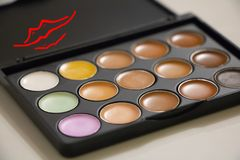 Eye shadow saturated colors. Palette with colors eye shadows cosmetics beautiful colors drawing lips royalty free stock photography
