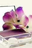 Eye shadow and silk flowers Stock Photography