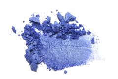 Eye shadow on a white background. Scattered blush sample for makeup. Blue color stock images