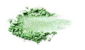 Eye shadow on a white background. Scattered blush sample for makeup. Green color. stock image