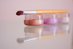 Eye shadows and brush. A still-life of some make-up essentials stock photography