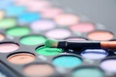 Eye shadows closeup. Eye shadow brush closeup, selective focus Stock Photography