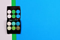 Eye shadows on colorful geometric background. Simple, Mimalism wallpaper. Make up concept Stock Photos