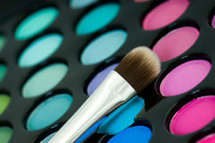 Eye shadows with cosmetics brush Royalty Free Stock Photo