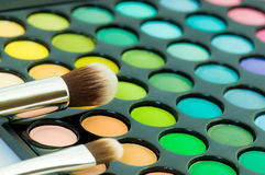 Eye shadows with cosmetics brush Stock Image