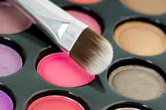Eye shadows with cosmetics brush Stock Images