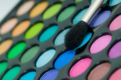 Eye shadows with cosmetics brush Royalty Free Stock Photography