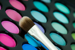 Eye shadows with cosmetics brush Stock Photo