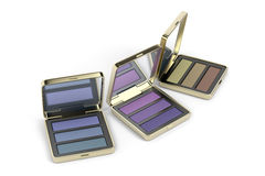 Eye shadows in gold boxes Royalty Free Stock Image