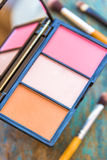 Eye Shadows Palette. Eye shadow makeup palette with brushes. Closeup and selective focus on eye shadow makeup palette stock images