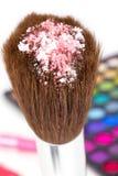 Eye shadows on professional make-up brush Stock Photography
