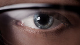 Eye shot through glasses Stock Images