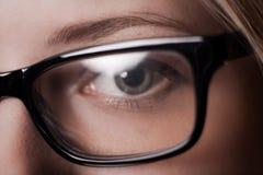 Eye shot through glasses Royalty Free Stock Images