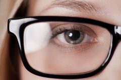 Eye shot through glasses Royalty Free Stock Images