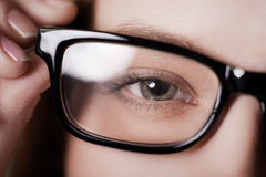 Eye shot through glasses Stock Photography