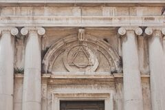 Free Eye Sign Inside Triangle On Building Of Church Of St. Magdalena, Venice, Italy Stock Photos - 177571453
