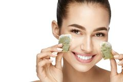 Eye Skin Beauty. Young Woman With Natural Facial Makeup. Holding Green Tea Bags On White Background. High Resolution stock images