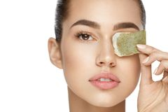 Eye Skin Care. Beautiful Woman With Green Tea Bag Under Eyes Royalty Free Stock Images