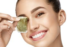 Eye Skin Care. Beautiful Woman With Green Tea Bag Under Eyes Stock Images