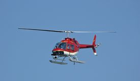 Eye in the sky 2. A bright red helicopter with a camera at a Fleet Week Air Show in 2006. A little motion blur on rotor blades Royalty Free Stock Images