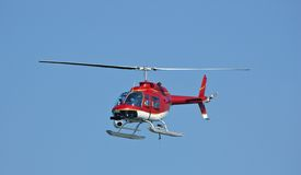 Eye in the sky 2. A bright red helicopter with a camera at a Fleet Week Air Show in 2006. A little motion blur on rotor blades Royalty Free Stock Photo