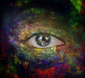 The eye of space. Surrealism. Woman`s eye with earth reflected  Some elements provided courtesy of NASA Stock Photos