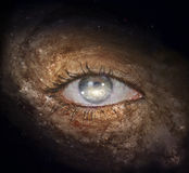 The eye of space. Surrealism. Woman`s eye with galaxies.  Some elements provided courtesy of NASA Royalty Free Stock Photography