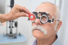 Eye specialist determines distance eyes pupils to patient Royalty Free Stock Images