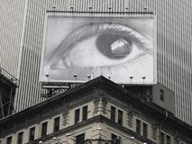 Eye Spy Billboard in Times Square, New York City. This is a black & white image of a billboard advertising a human eye looking down on Times Square in New York Stock Photo