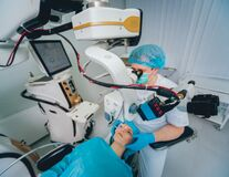 Free Eye Surgery. A Patient And Surgeon In The Operating Room Stock Photography - 182436942