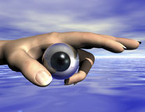 Eye. Surrealistic composition of eye and hand Royalty Free Stock Photo