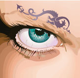Eye with a tattoo. Royalty Free Stock Images