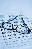 Eye test. Eye chart test with black glasses Royalty Free Stock Photography