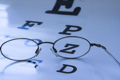 Eye test chart. Optometrist eye test chart blue royalty free stock photography