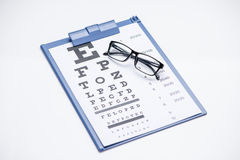 Eye test. Eye chart test with black glasses royalty free stock image
