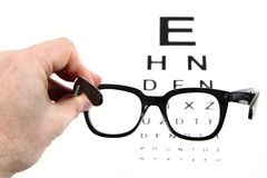 Eye test chart and black glasses Stock Photography