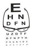 Eye test chart and black glasses Royalty Free Stock Image