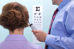 Eye test at the opticians Royalty Free Stock Photo