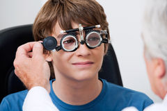 Eye Test Through Trial Frames Royalty Free Stock Photo