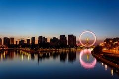 Eye of Tianjin. The Eye of Tianjin. A ferris wheel builded on the bridge Royalty Free Stock Photos