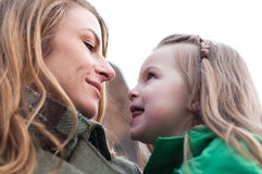Eye-to-eye contact of girl and her mom Stock Photos