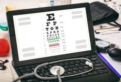 Eye vision test on a doctor`s computer screen Royalty Free Stock Photos