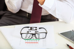 Eye vision test and a pair of glasses Royalty Free Stock Photography