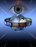 Eye watches earth film Royalty Free Stock Photography