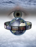Eye watches earth film. In Surreal Cloudscape Stock Image