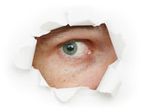 Eye is watching us through a hole Royalty Free Stock Photos