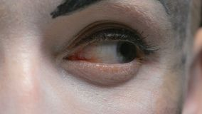 Eye of woman with white make up stock video footage