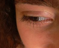 The eye of a young girl. An close-up shot of the face of an young girl showing only the right eye Stock Photo